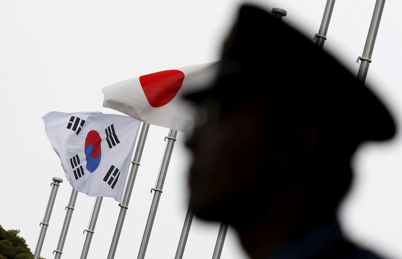 South Korea warns Japan of security pact risk, calls for