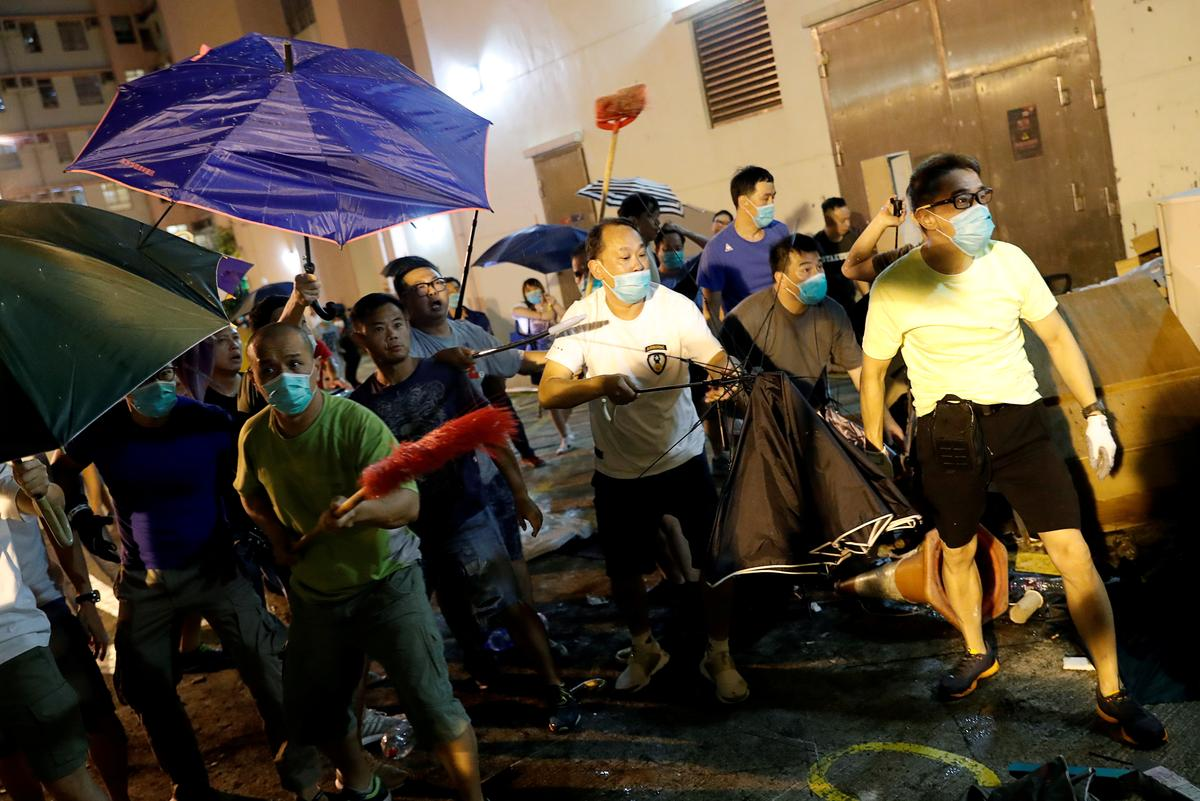 Hong Kong police fire tear gas as city is again roiled by protests