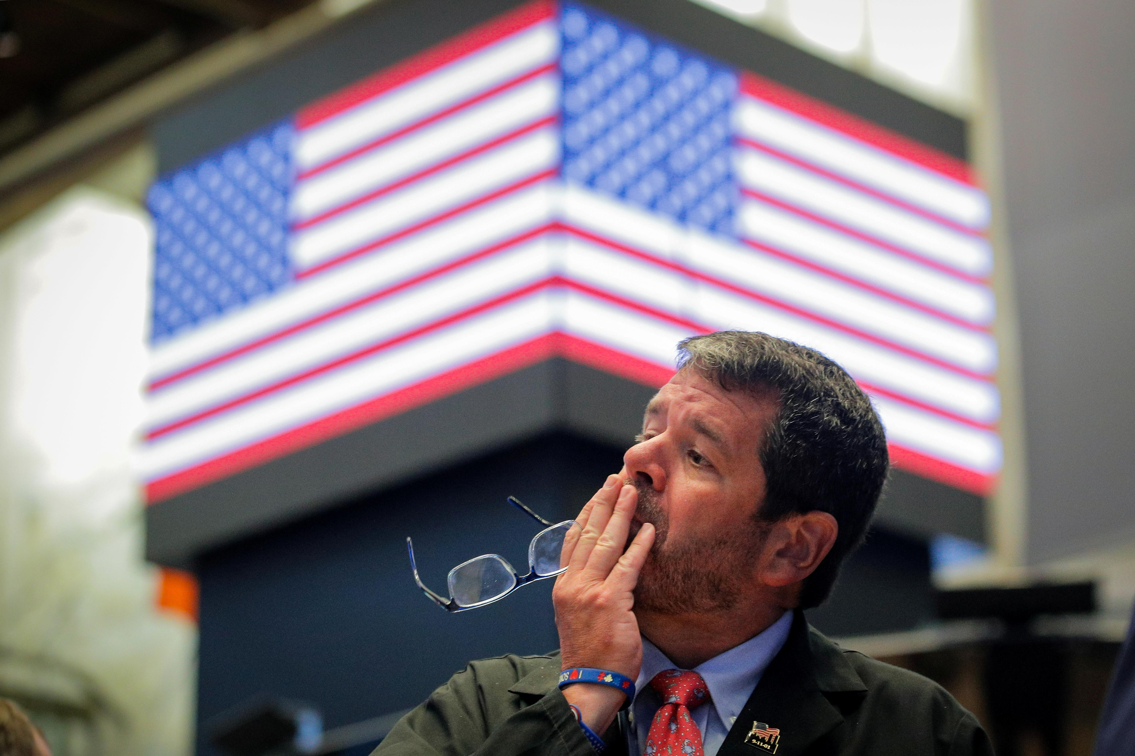 Wall St. sinks as yuan slide intensifies U.S.-China trade dispute