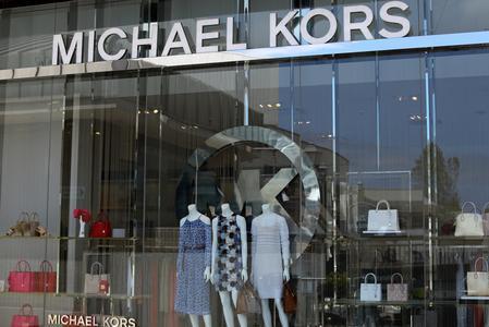 Capri cuts sales forecast as Michael Kors demand slows