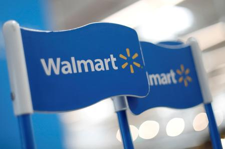 Walmart raises earnings forecast for year after jump in quarterly sales