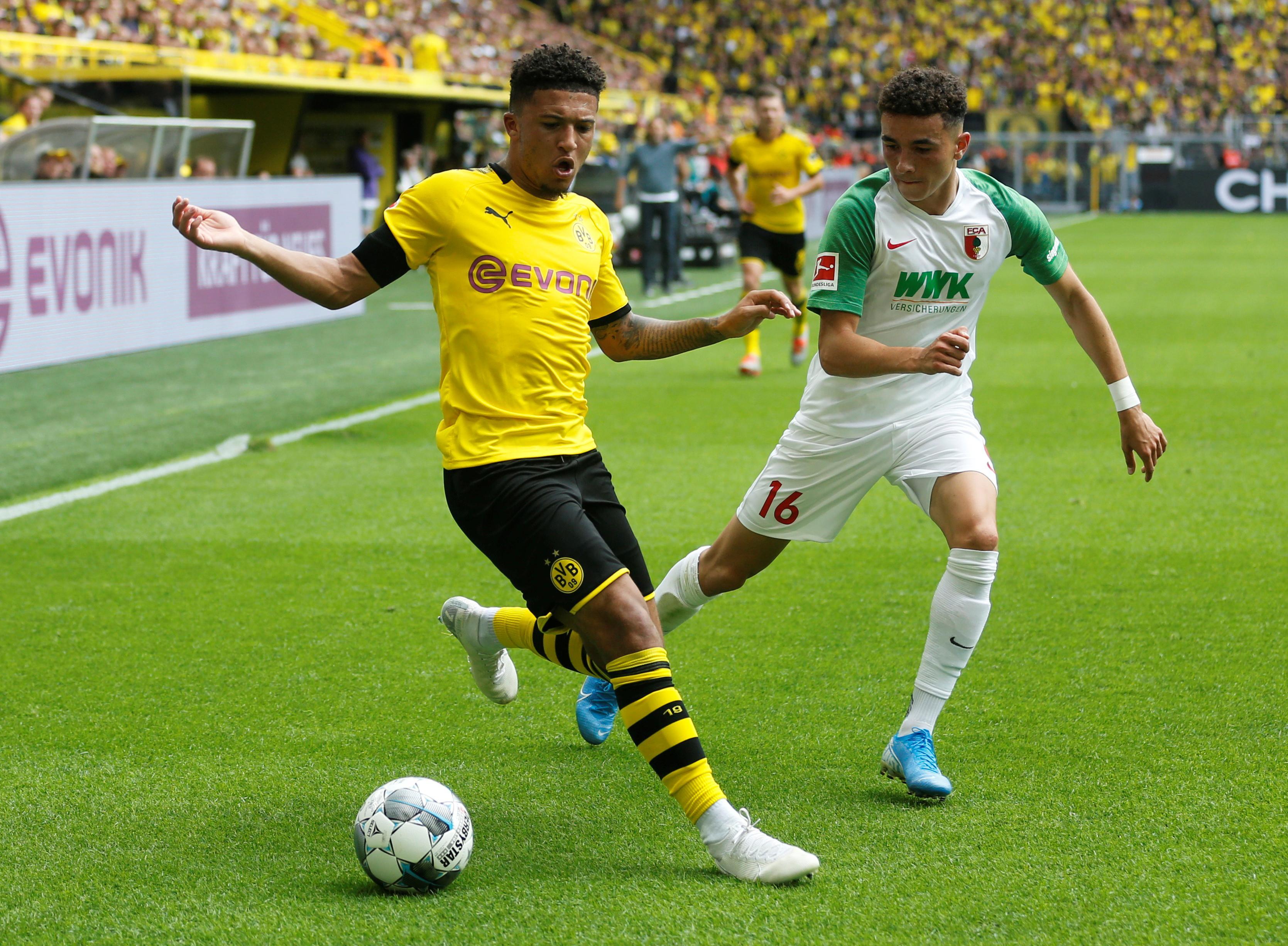 Dortmund crush Augsburg to set title marker in season opener