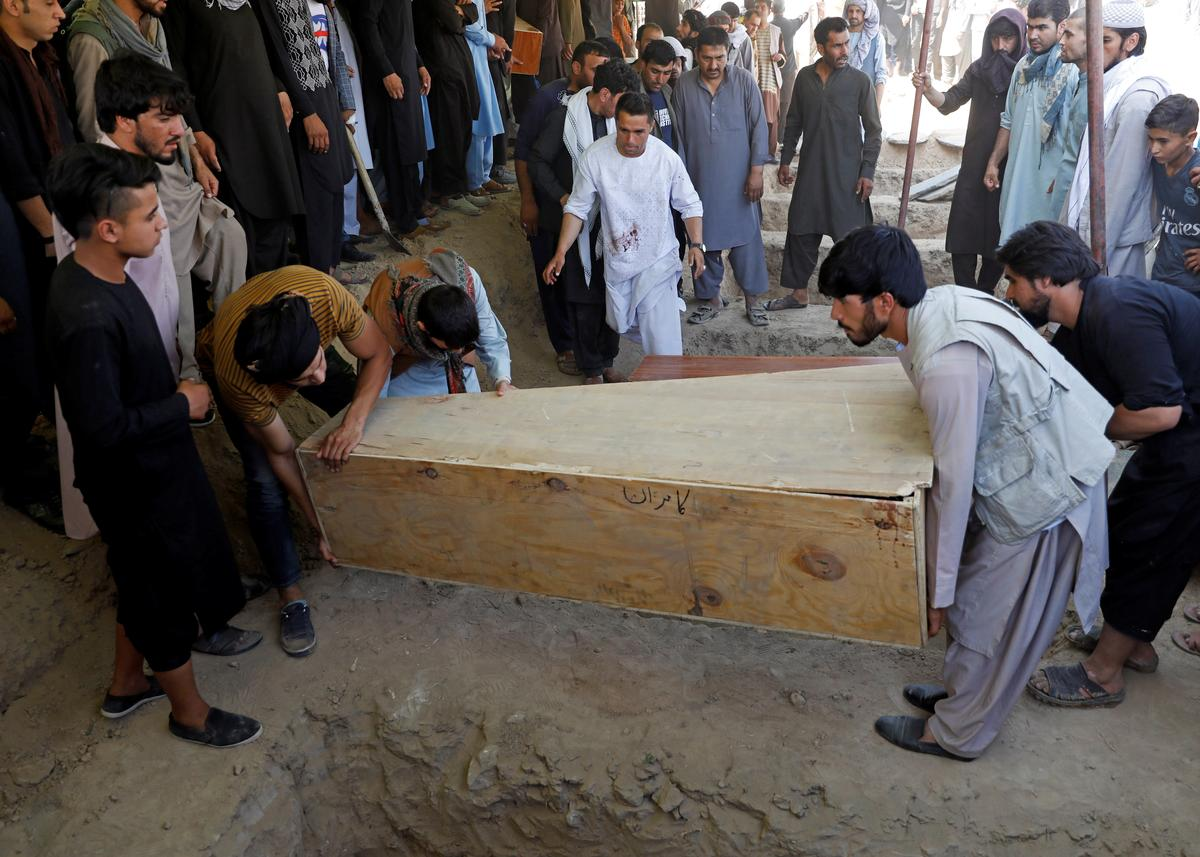 Islamic State claims Afghan wedding blast as families bury the dead