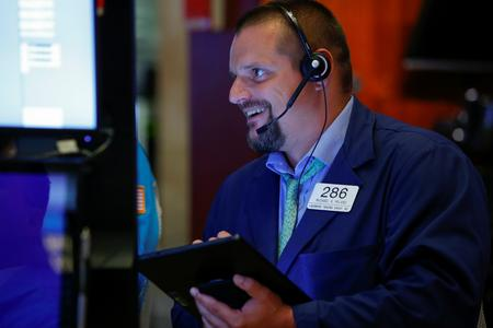 Wall St. slips after three days of gains; Home Depot rises