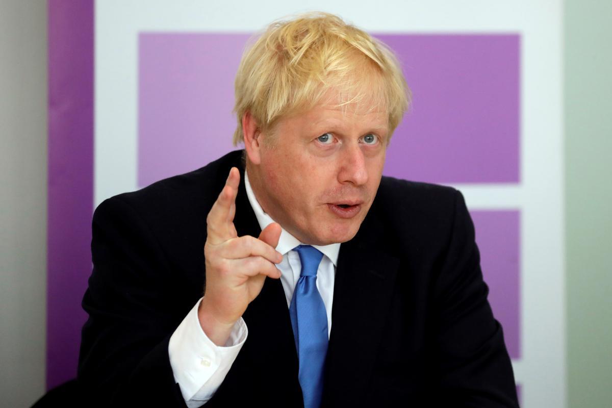Die Britse premier Johnson dring Merkel aan om op Brexit te beweeg