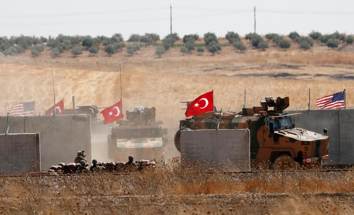 Turkish military enters Syria to begin joint U.S. 'safe zone' patrol
