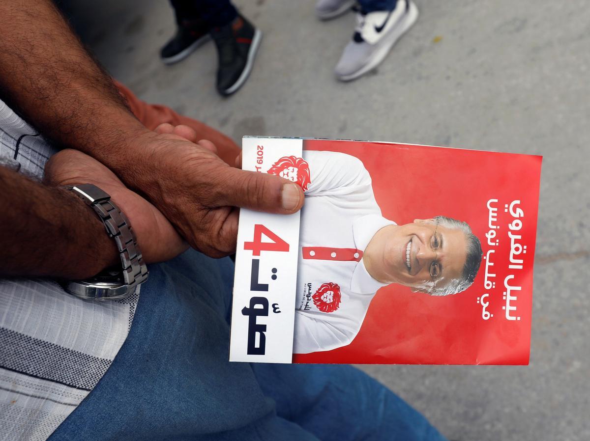 Woordvoerder van die Tunisiese kandidaat Karoui sê hy is deur na die volgende ronde
