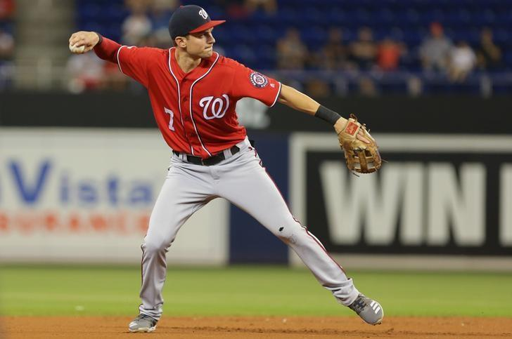 Nats win DH opener, ending Phillies' playoff hopes