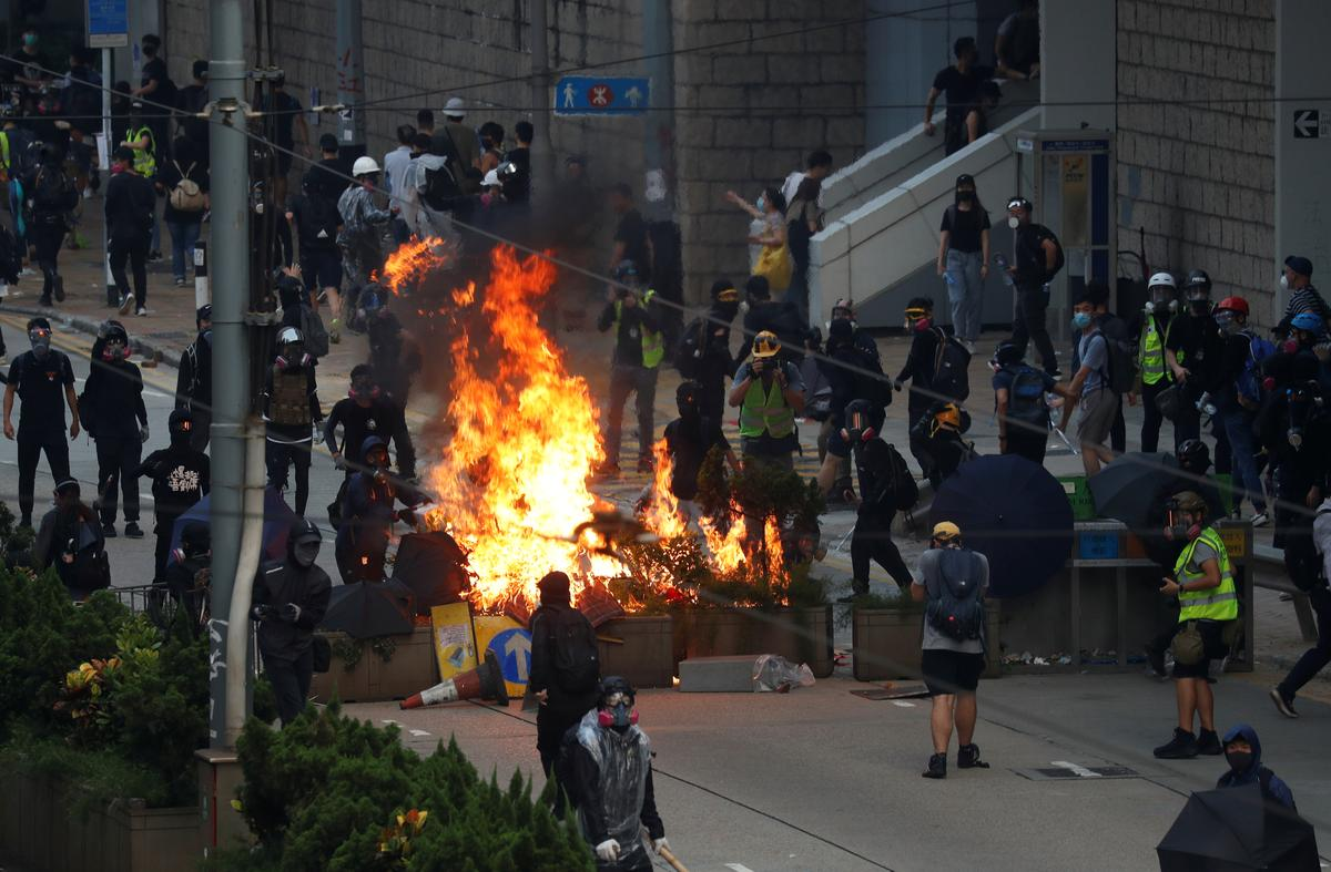 Street fires burn in Hong Kong amid running battles between protesters and police
