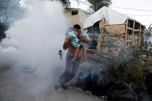 Deadly fire sparks clashes at crowded Greek migrant camp