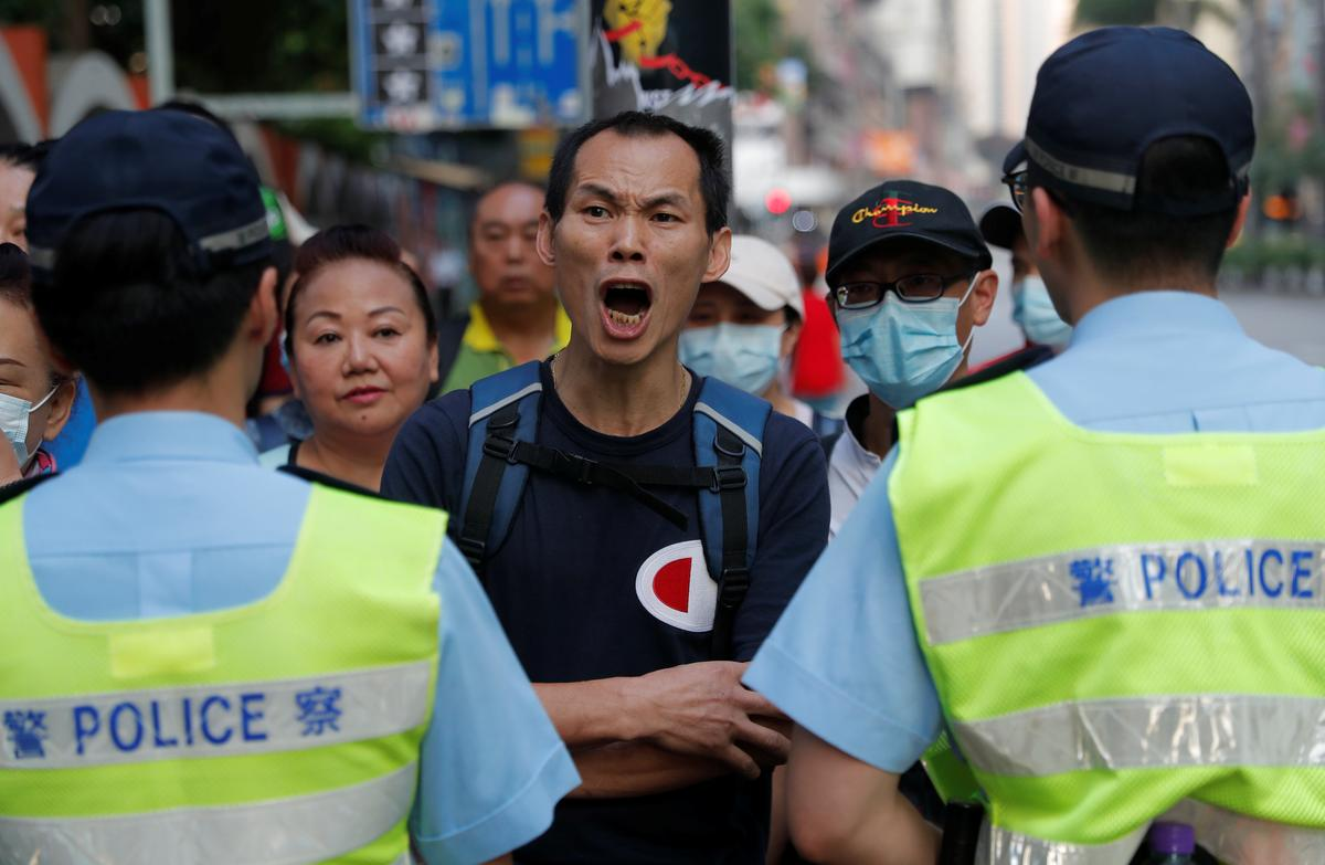 Restive Hong Kong hunkers down as China's birthday celebrations begin