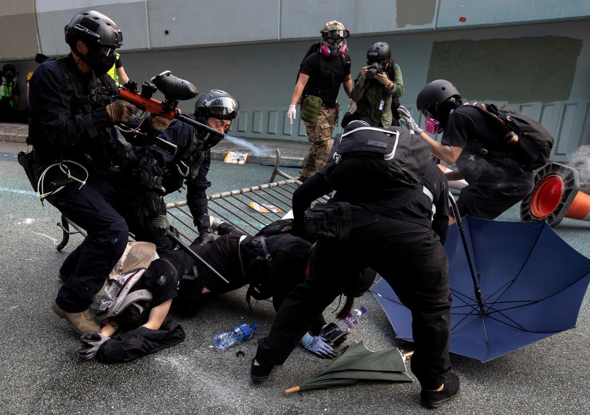 Die polisie in Hongkong verander riglyne oor die gebruik van geweld in betogings: dokumente