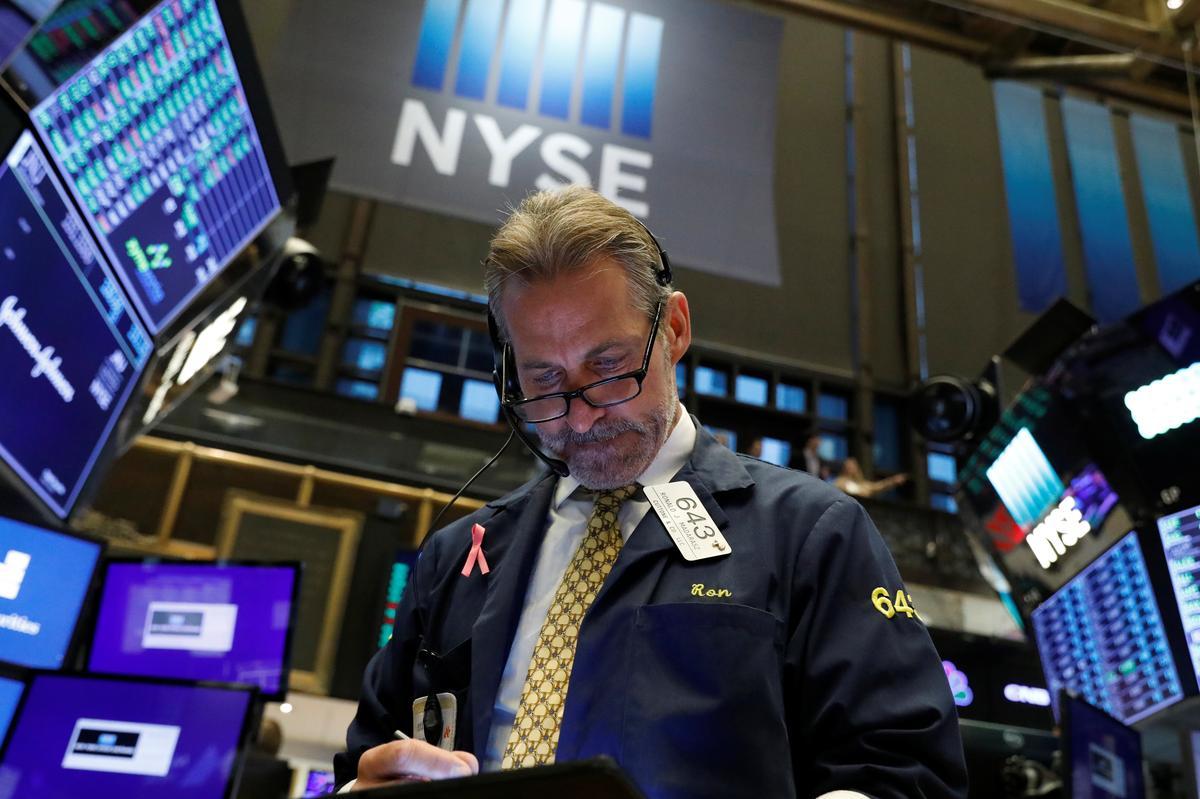 Stocks rise, dollar slides, with eyes on U.S.-Sino trade talks