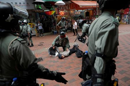UPDATE 1-Hong Kong protesters stage shopping mall rallies taunting riot police