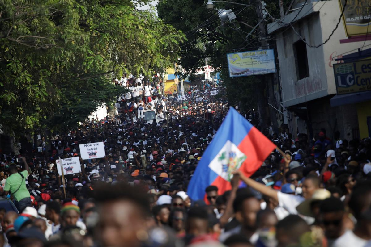 Singing and dancing, Haitians flock to streets in anti-government...