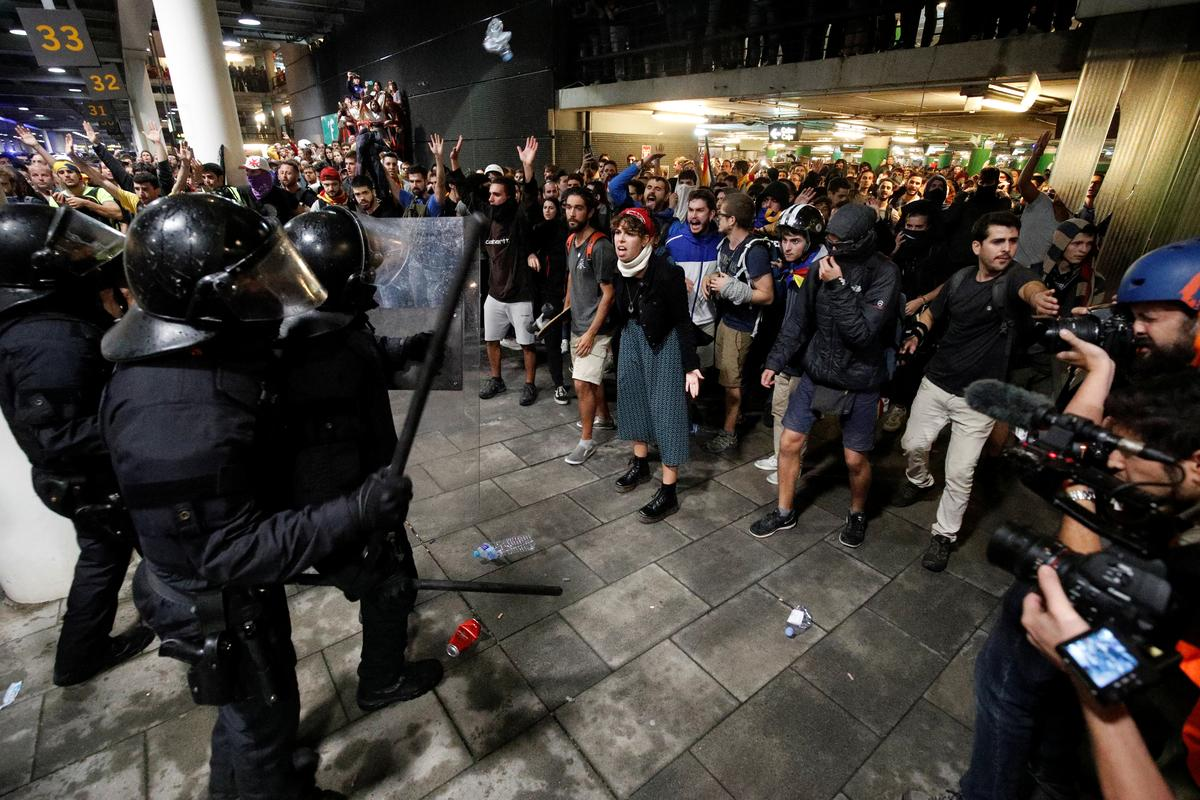 Spain jails Catalan separatist leaders, protesters flood streets