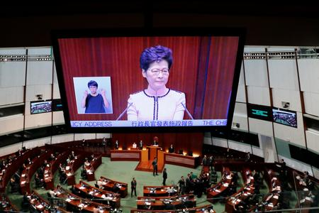UPDATE 5-Hong Kong leader forced to abandon address, offers no olive branch