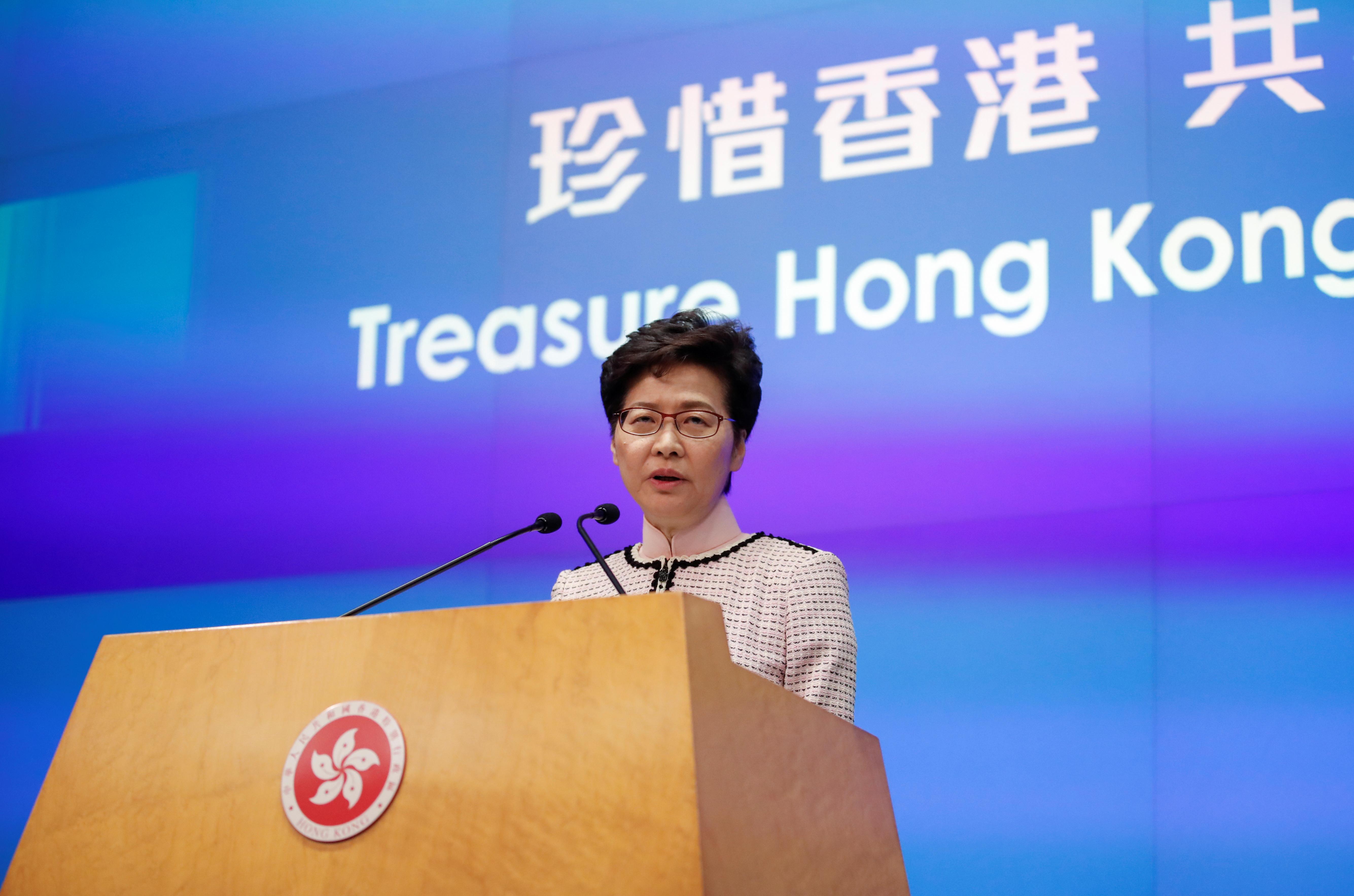Hong Kong leader says city's status as financial hub not shaken