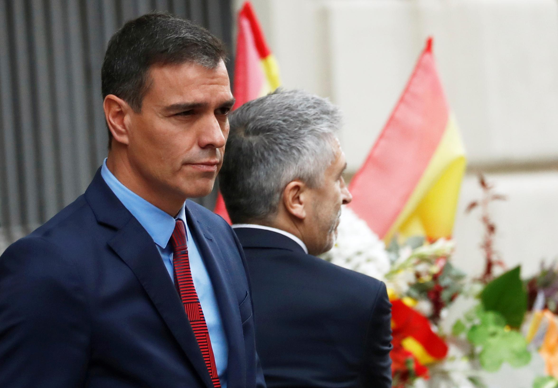 Spanish PM visits Barcelona, criticises regional chief