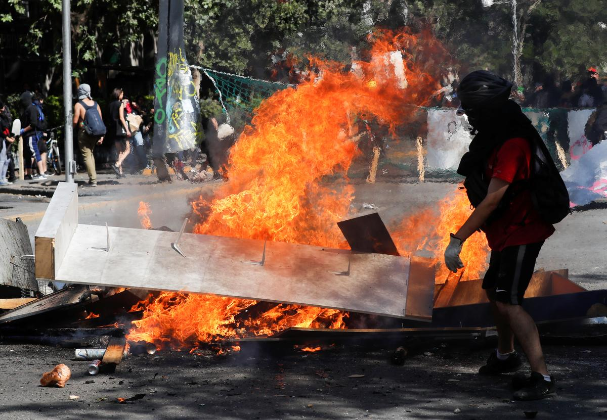Chile protesters stay in streets as Pinera says their demands 'loud and clear'