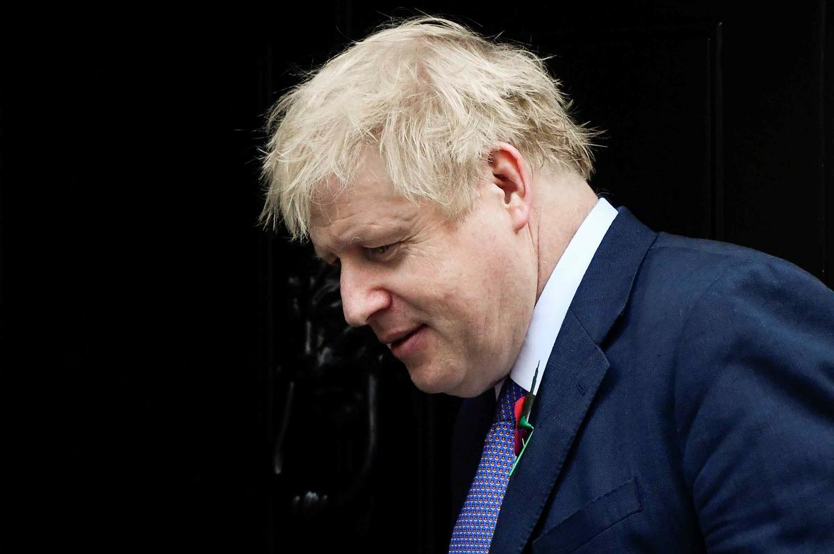 British PM Johnson signs book of condolences for 39 truck dead