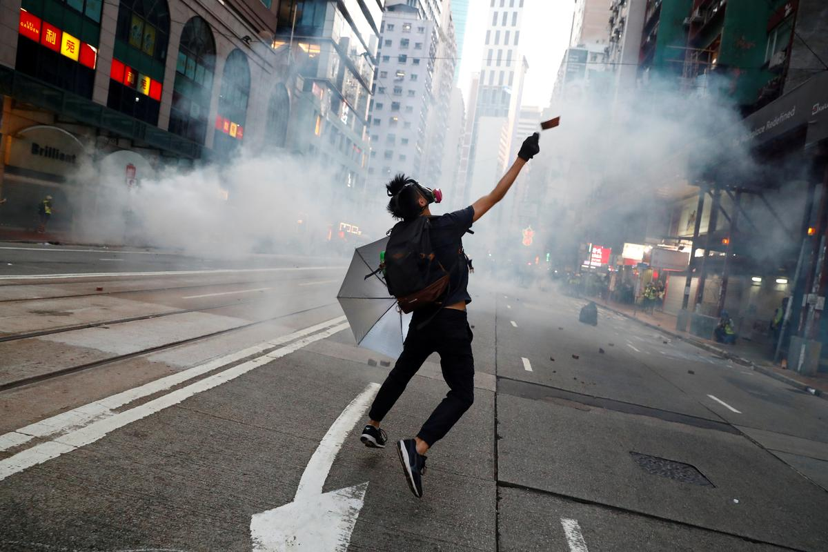 Hong Kong braces for protests as two critical after weekend clashes