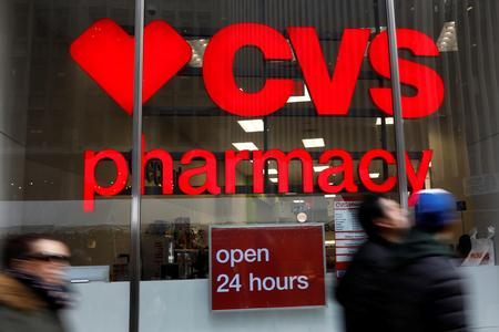 UPDATE 4-CVS quarterly profit beats expectations; shares rise as it eyes growth