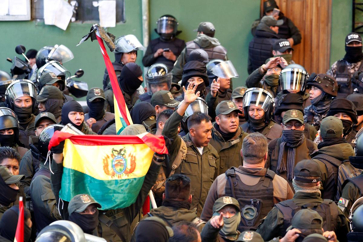 Bolivian government decries coup as some police join protests