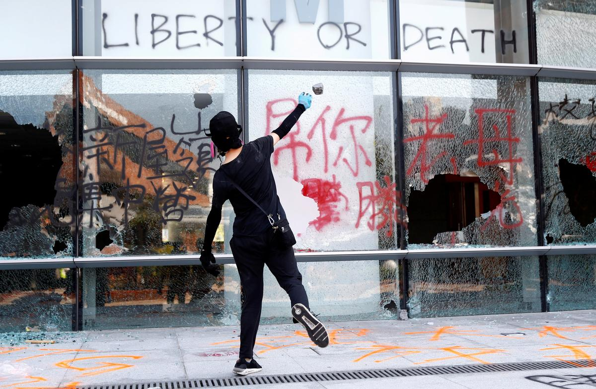 Hong Kong spirals into rare working-hour violence as police shoot protester