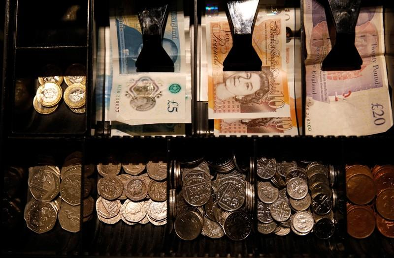 Sterling falls slightly with traders still hopeful of Conservative...