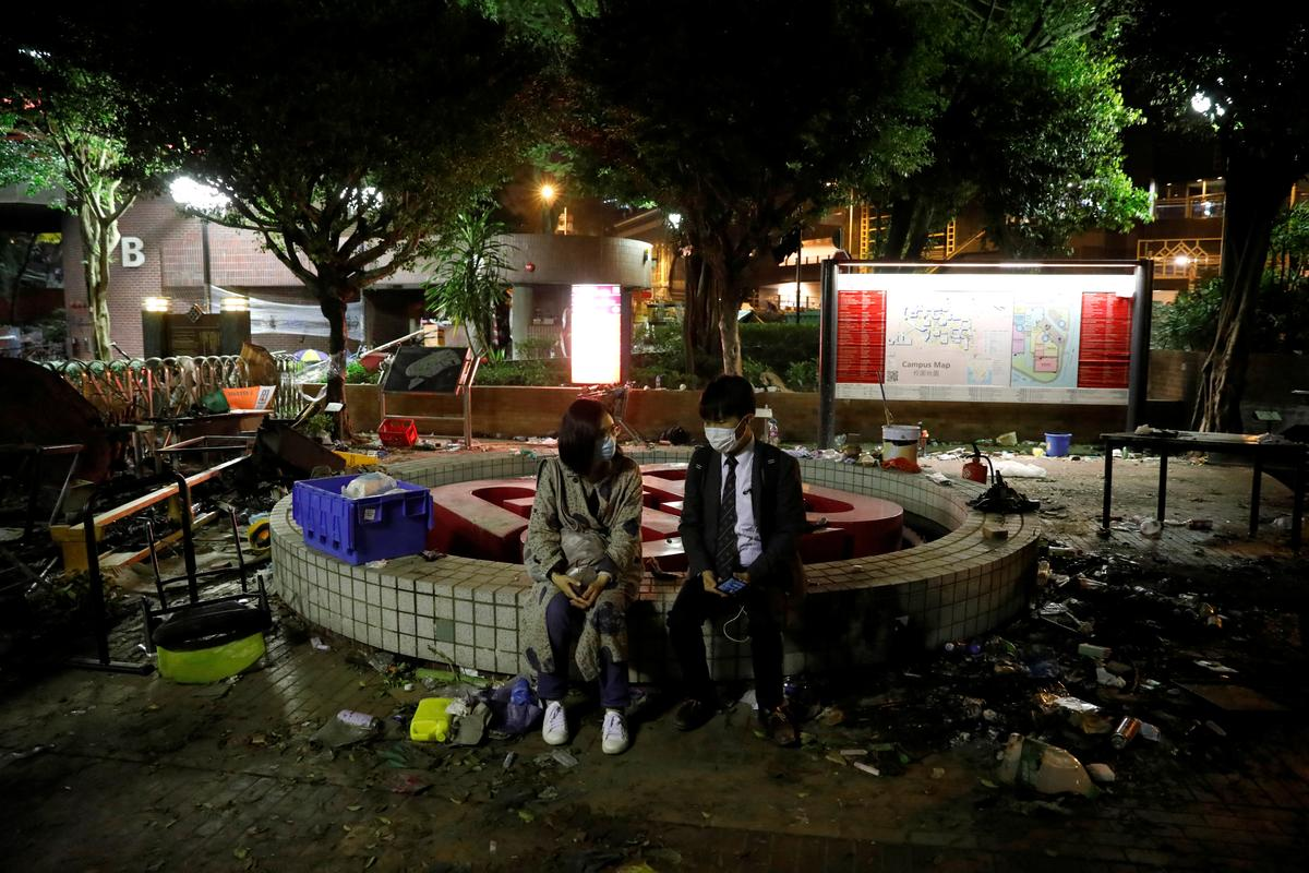 Hundreds of protesters leave Hong Kong university, many remain