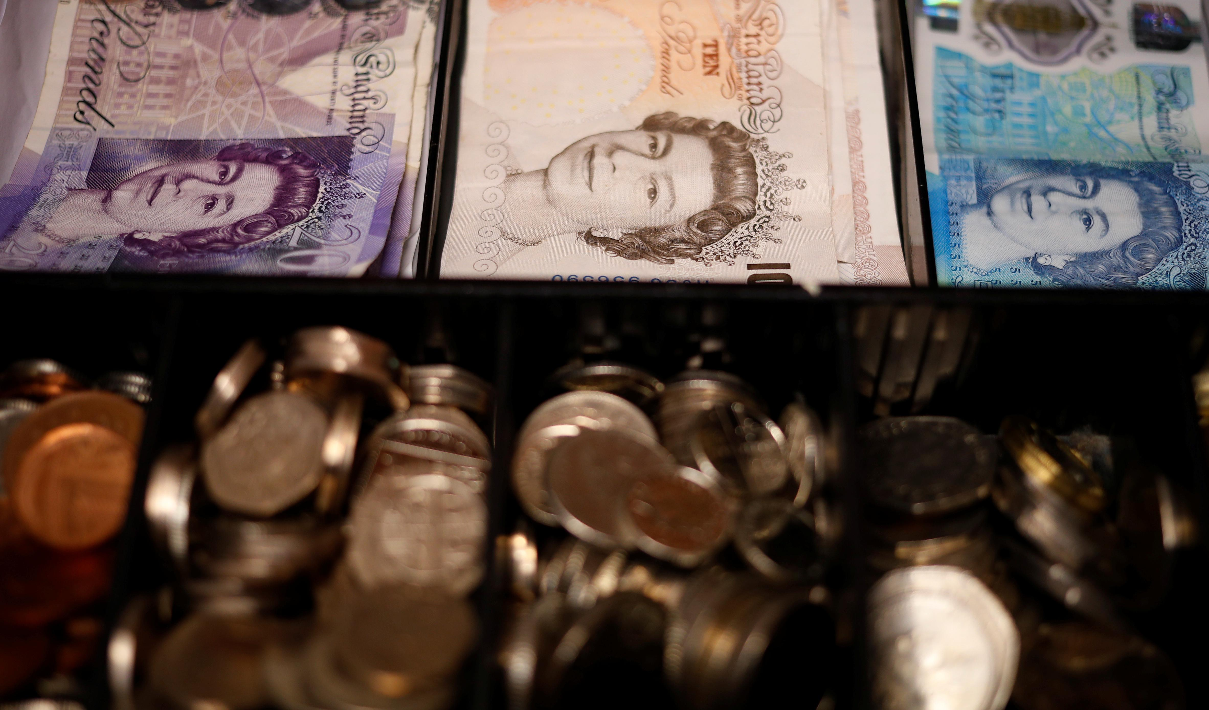 UK budget deficit hits five-year high, before election give-aways