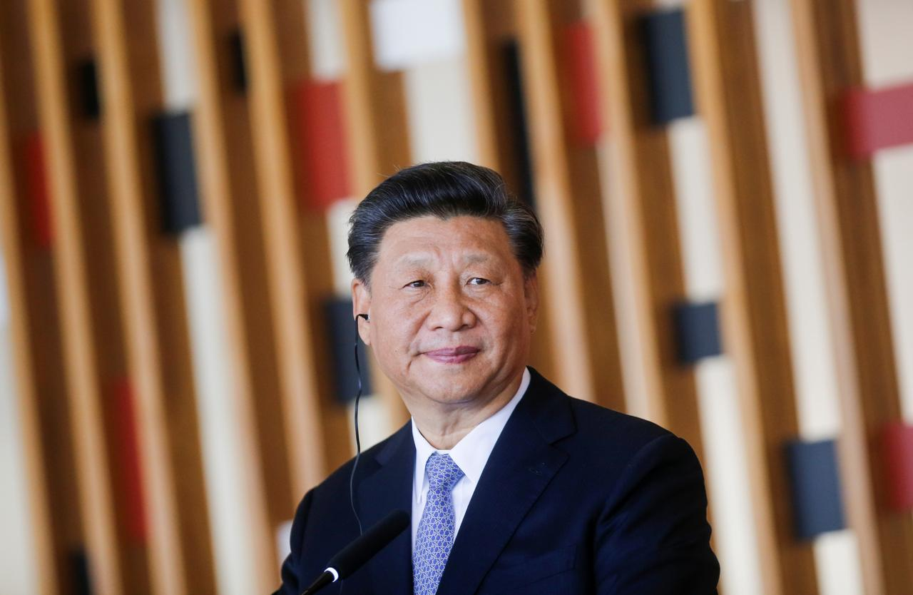 Image result for China's Xi says he wants to work out initial trade deal with U.S.