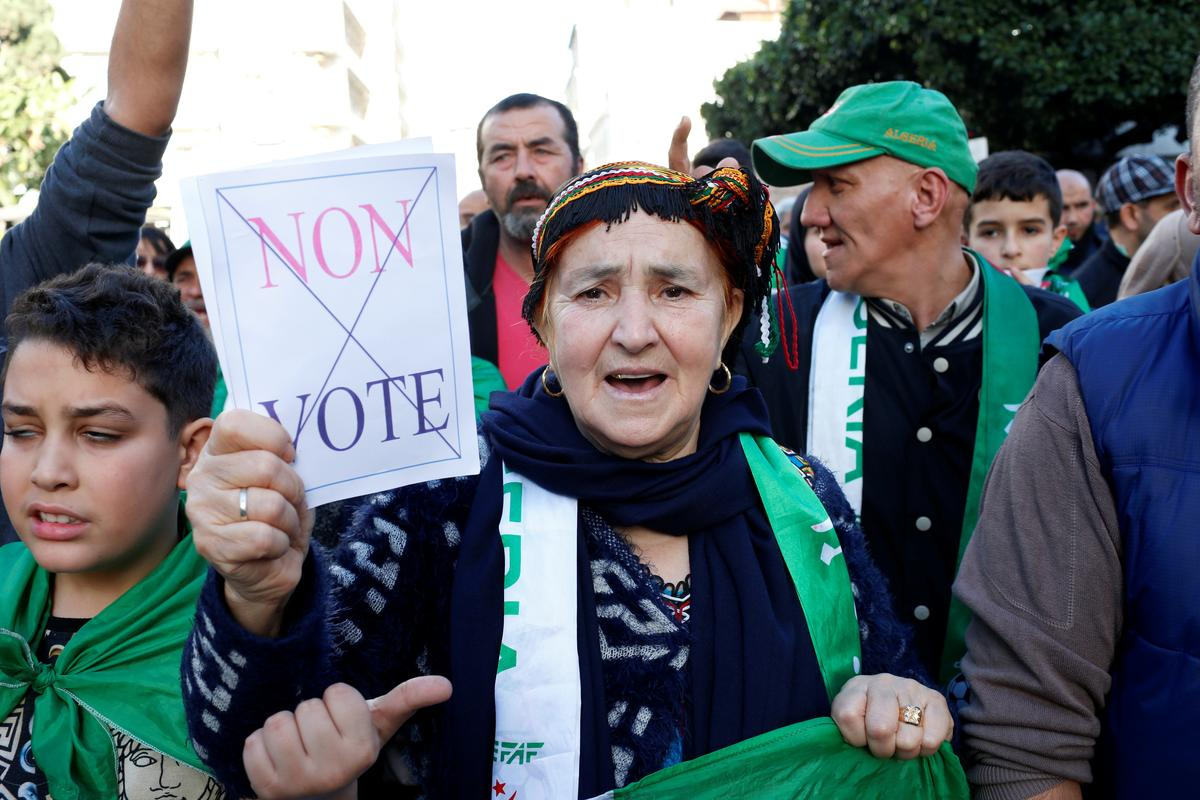 Algerian protesters march in last Friday rally before election