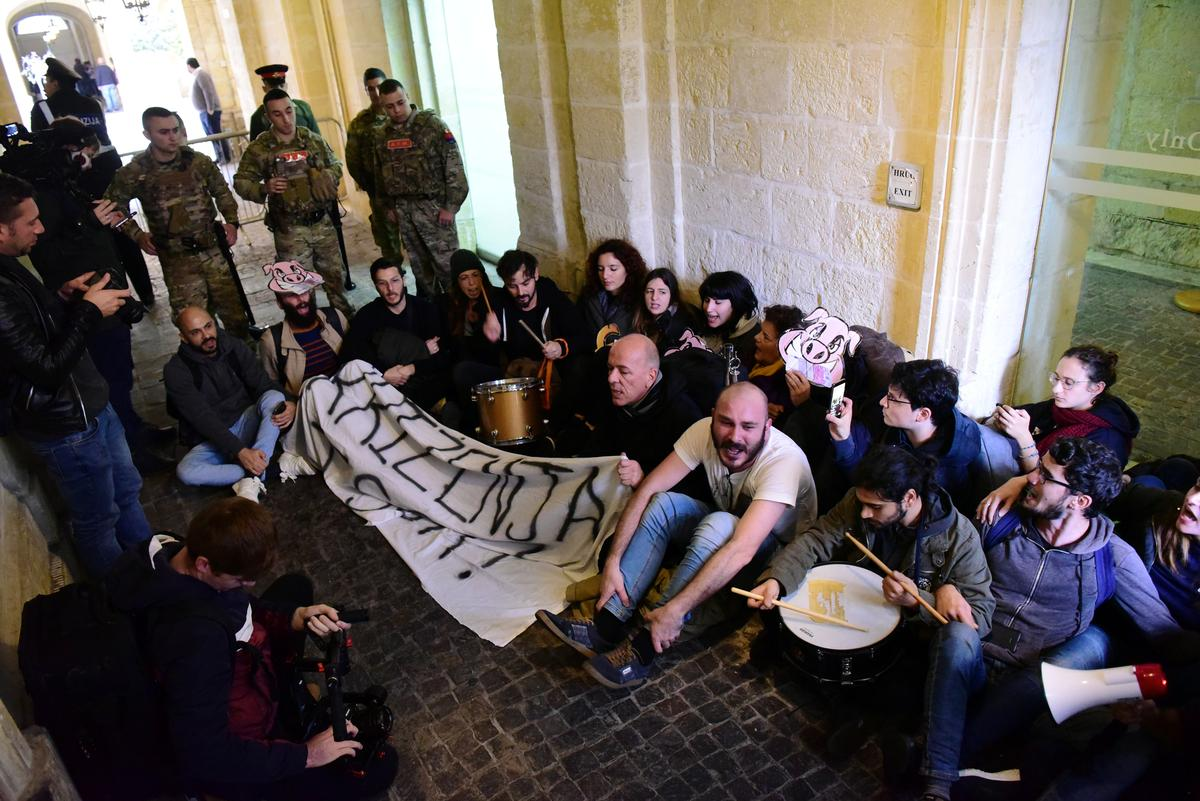 Activists storm into Maltese government HQ demanding PM's resignation