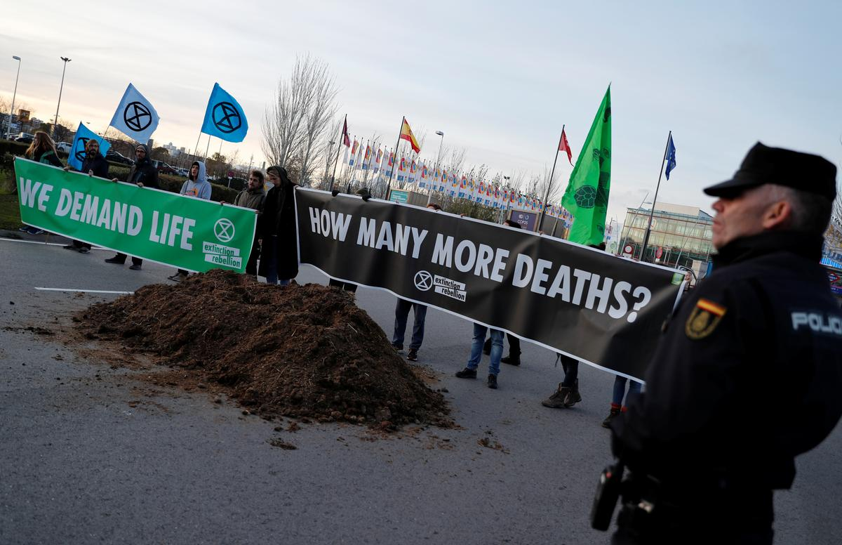 Frustrated with climate talks, activists dump manure outside Madrid...