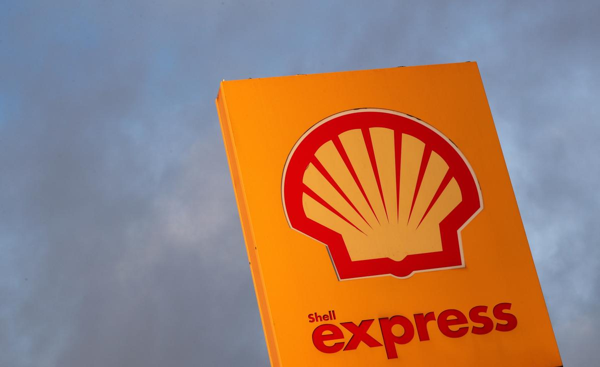 Shell sees $2.3 billion charges, trims output estimate