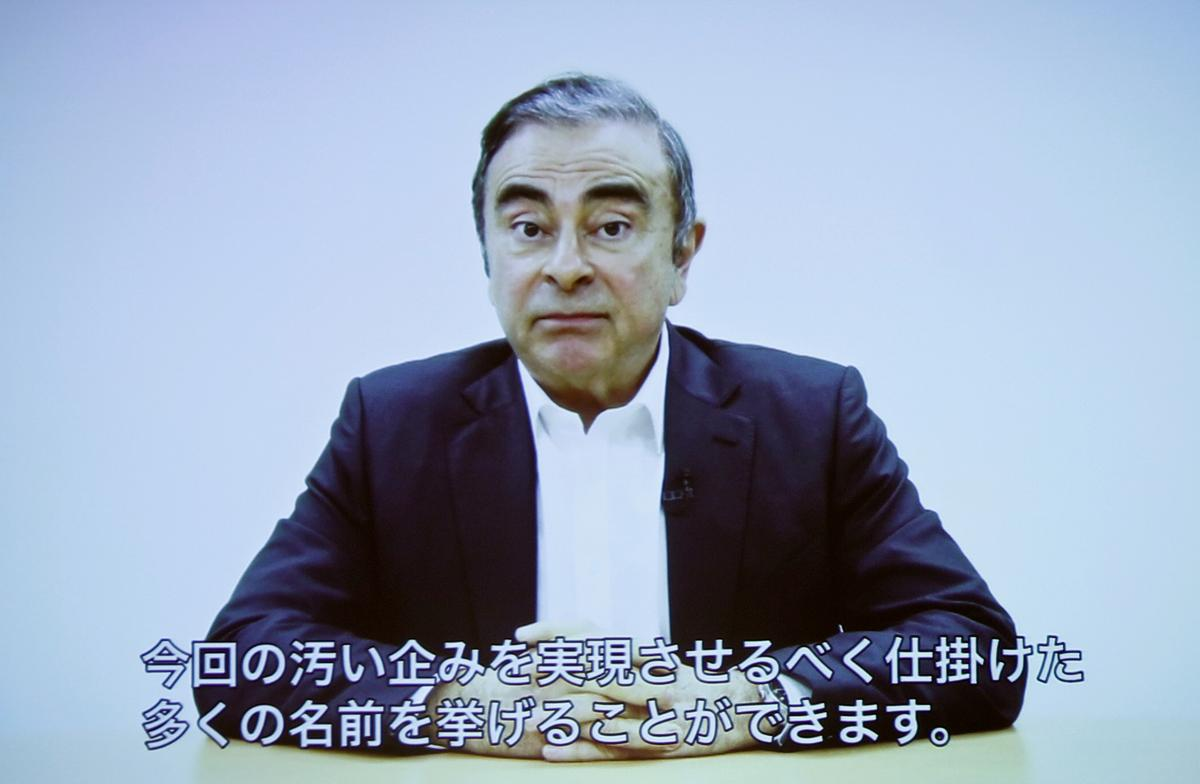 Ghosn carried spare French passport while out on bail in Japan: NHK