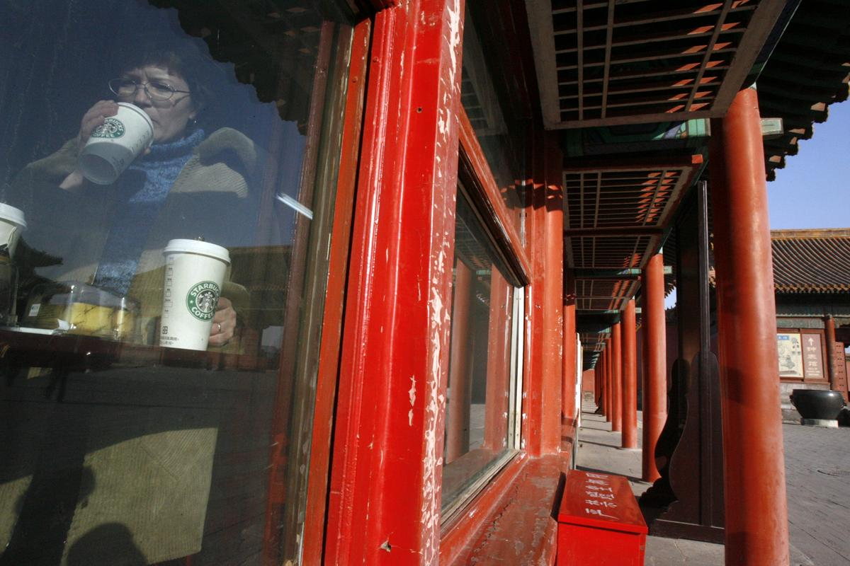Starbucks shuts shops, suspends delivery in China's Hubei amid...