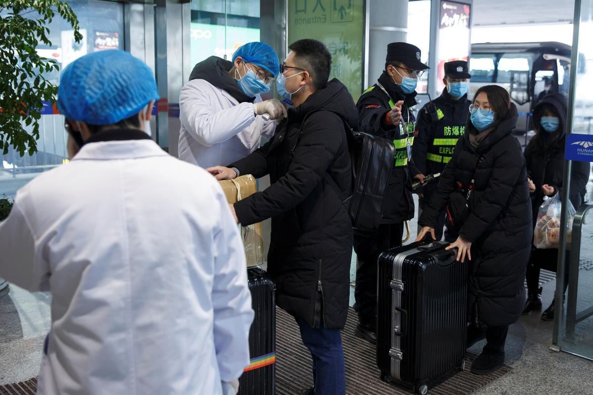 Malaysia bans travelers from virus-affected area in China