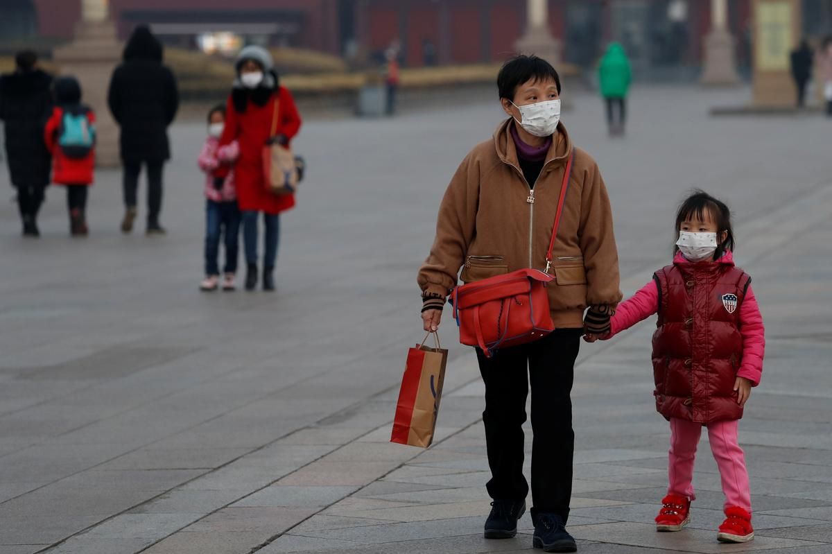 China's Beijing suspends most bus services to Hebei to curb virus spread