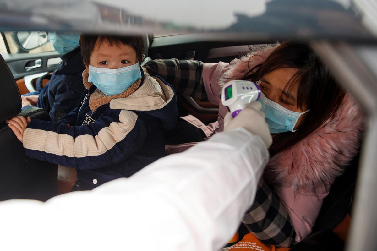 China records first virus death in Beijing as toll passes 100
