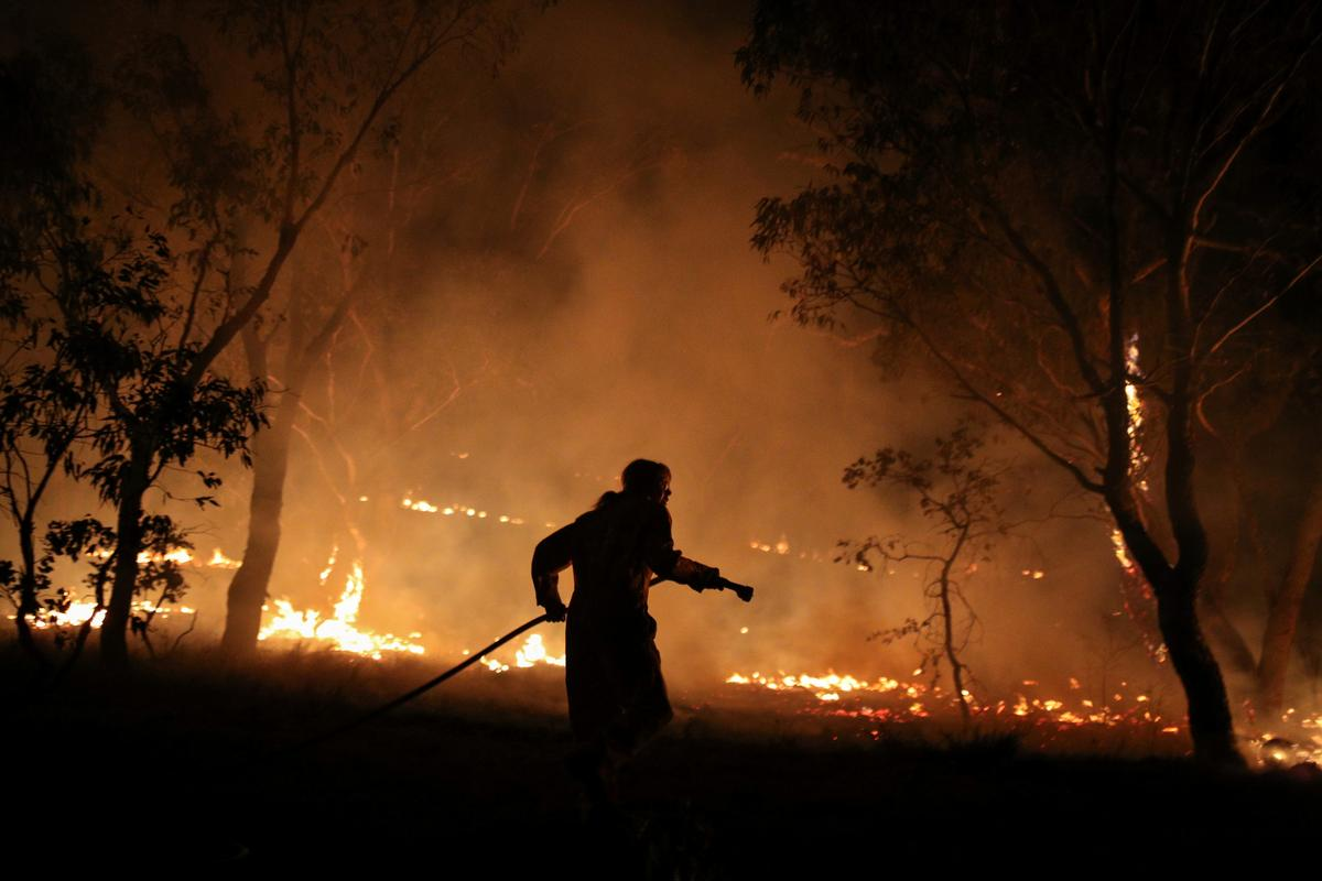 Australia's most populous state says fires contained for the first time in nearly six months