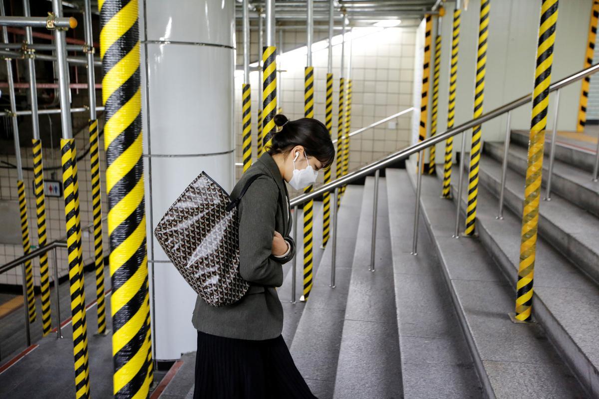 'Like a zombie apocalypse': Residents on edge as coronavirus cases surge in South Korea