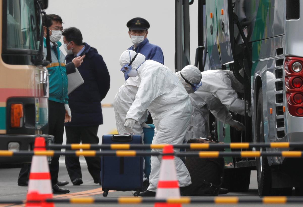Two passengers from coronavirus-hit cruise ship in Japan die, authorities defend quarantine