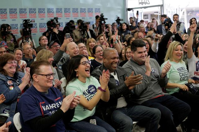 FILE PHOTO: Supporters laugh as U.S. Democratic presidential candidate Senator Elizabeth Warren holds a ''Canvass Kickoff'' event at her campaign field office in North Las Vegas, Nevada, U.S. February 20, 2020.   REUTERS/David Ryder
