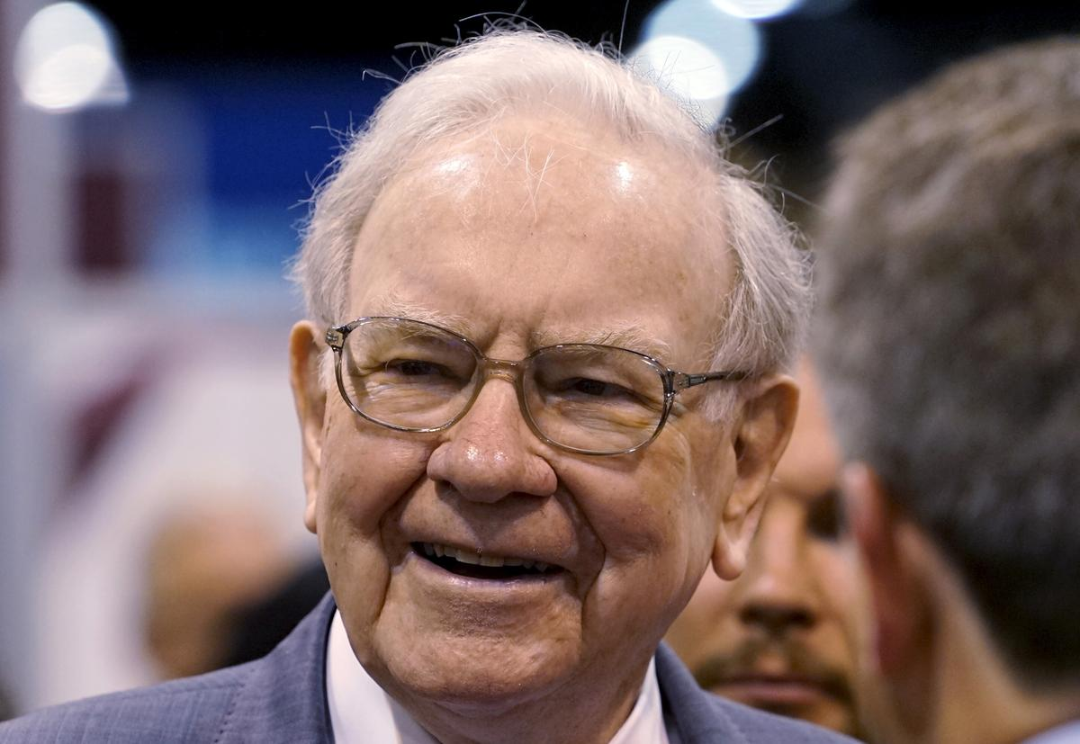 Rising stocks fuel record profit for Buffett's Berkshire; operating profit disappoints