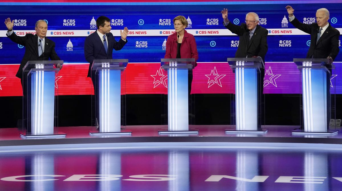 Rivals question the eligibility of first place Sanders to South Carolina's turbulent democratic debate