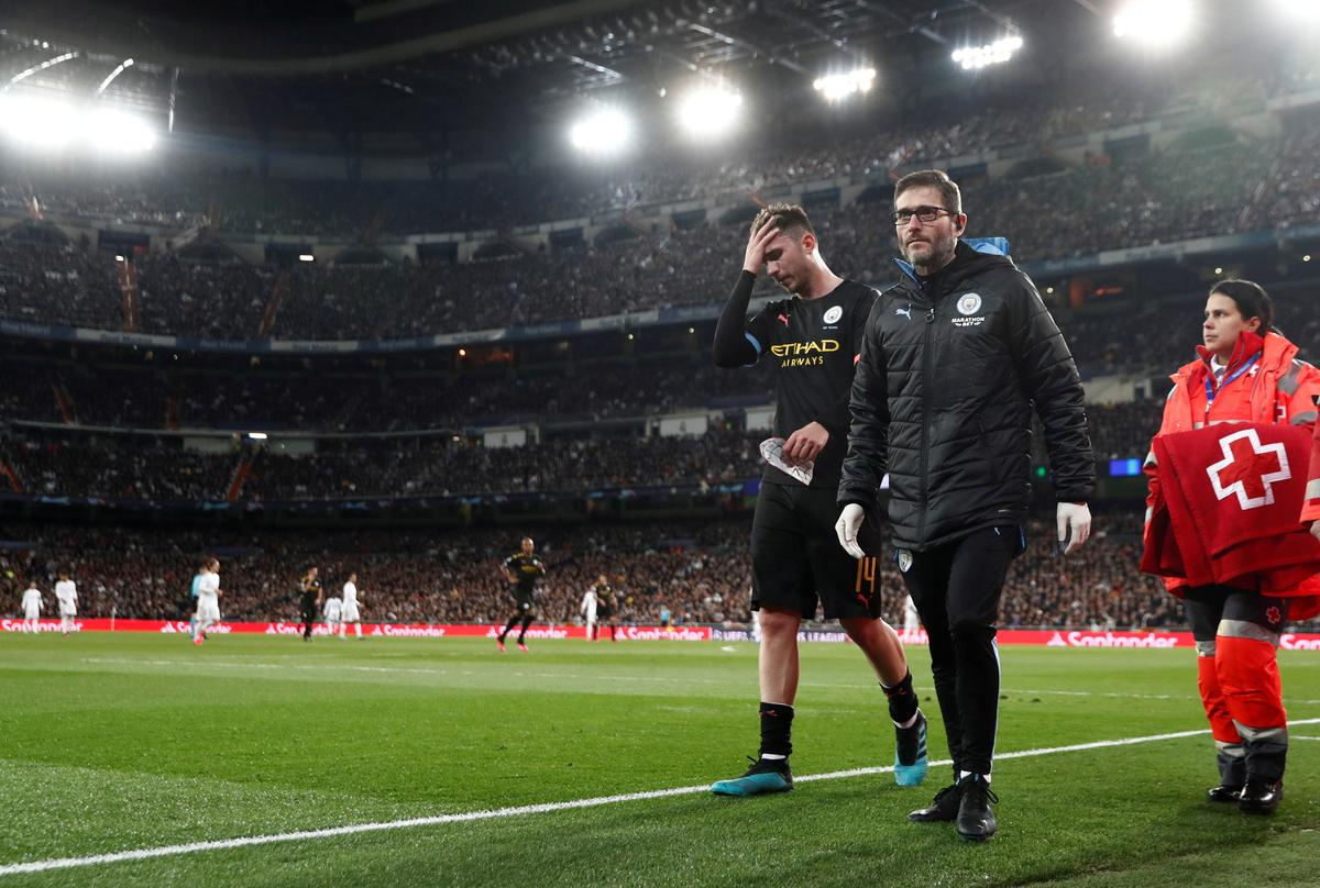 Laporte out for up to a month with hamstring injury, says Guardiola