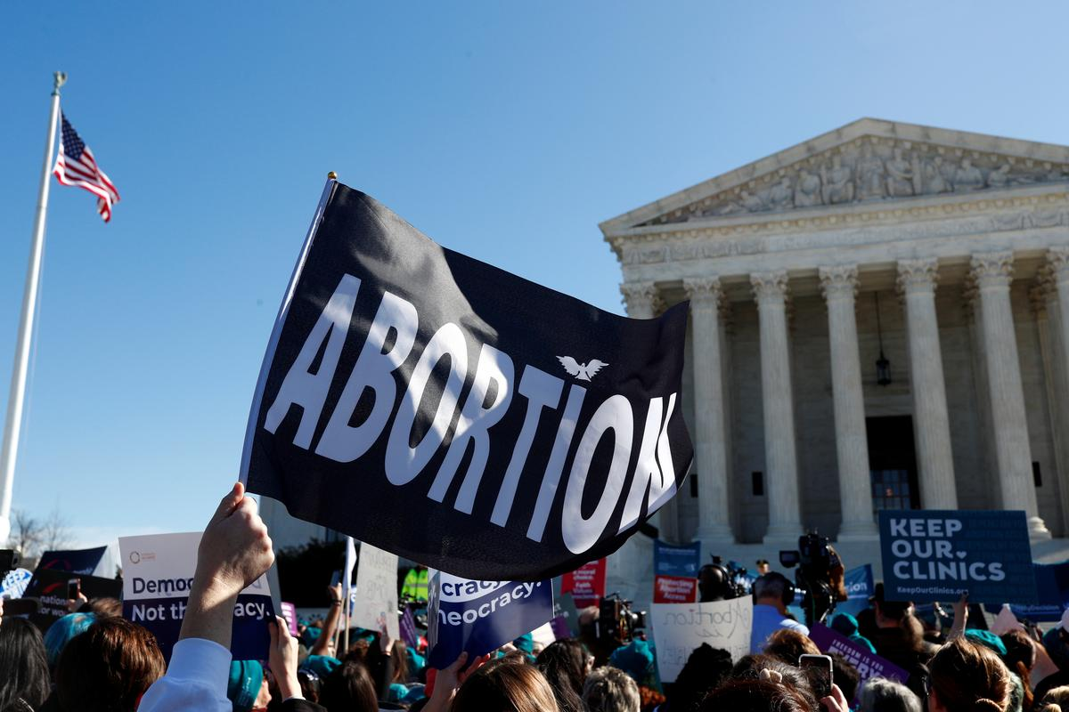 U.S. Supreme Court justices divided in abortion case; Roberts may hold key